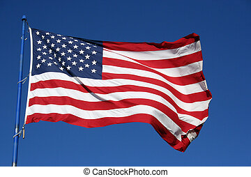 American Flag - An American flag flaping boldly in the wind