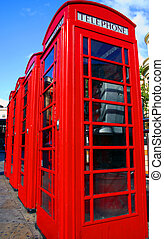 Telephone boxes - A row of tradition British red telephone...