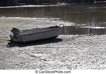 Beached Boat - Boat beached on a mudflat