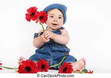 Spring Baby - A baby girl dressed in denim is holding...