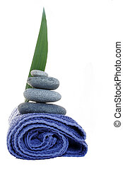 Hotel Towel - Isolated towel with pebble stack and leaf;...