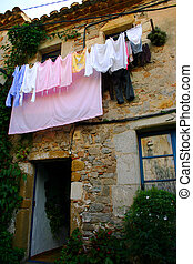 Wash Day - Washing hanging outside a Spanish house