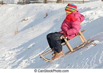 Sledding - A little girl sledding