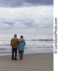 Love That Lasts - Elderly couple by looking out over the...