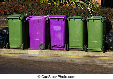 Dustbins 01 - A row of purple and green waste-bins in...