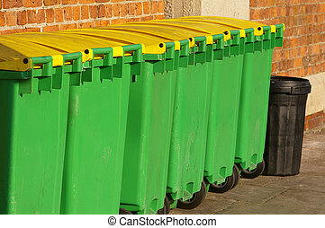 Dustbins 03 - A series of green and yellow waste-bins down...