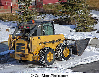 bob-cat - clearing snow with a bob-cat