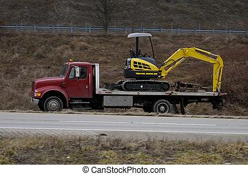Flatbed Truck - Flatbed Hauling Backhoe
