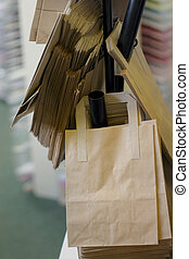 Brown bag - brown paper bags in a shop