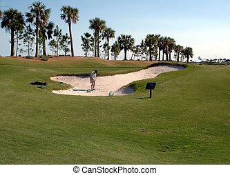 Golfer In Sand Trap - Photographed a golfer in a sand trap.