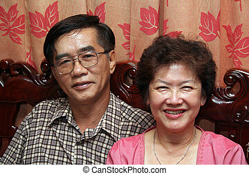 Happy Couple - A happy, middle-aged asian couple.