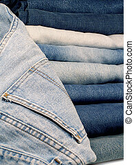 Denim Blue Jeans - A stack of folded denim blue jeans.
