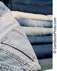 Denim Blue Jeans - A stack of folded denim blue jeans.