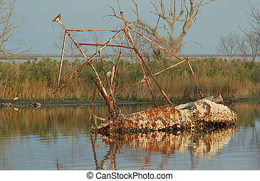sunken shrimp boat in bayou at Pointe-aux-Chenes, Louisiana
