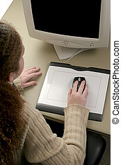 Graphic Tablet & Mouse - An overhead view of a girl using a...