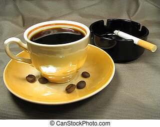 Is tasty but is harm - Cup of coffee and cigarette in an...