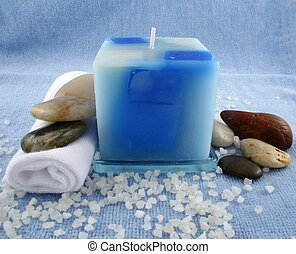 Blue Candle - A blue candle surrounded by bath crystals,...