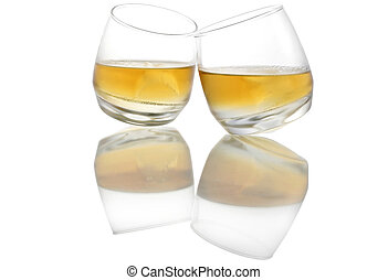 Whiskey Reflected - Two touching whiskey glasses with...