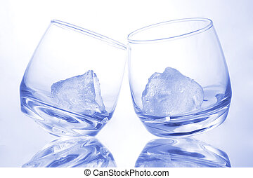 Blue as Ice - Ice in tilting glasses with blue hue
