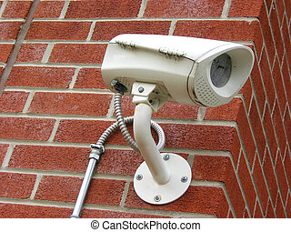 Security camera on a brick wall of a residential building