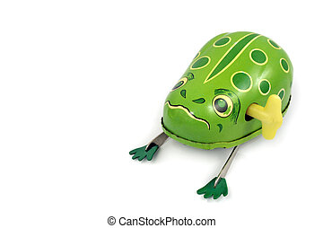 wind-up frog - wind-up toy frog set against a white...