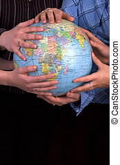 Hands On A Globe - Female Hands Holding A Globe