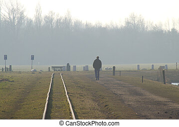 Along the railroad track - Men walking along the railroad...