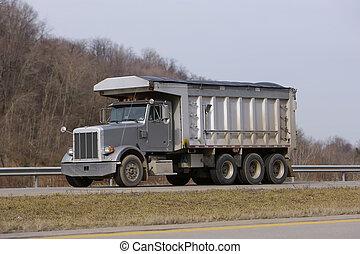 Grey Dump Truck on Highway