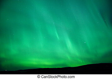 The sky glowing green - Aurora Borealis