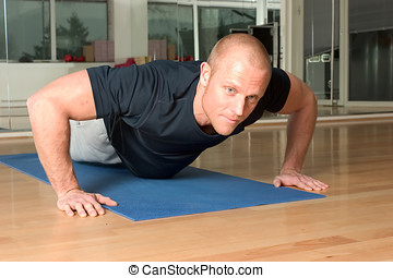 Pushup - Handsome blond man doing pushups in the gym
