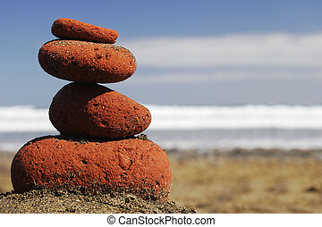Sunglasses Stack - Sunglasses on red stone stack on the...