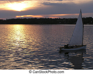 Sailing against sunset - Sailing at sunset in St Andrews by...
