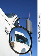 Truck with another showing in it\\\'s mirror