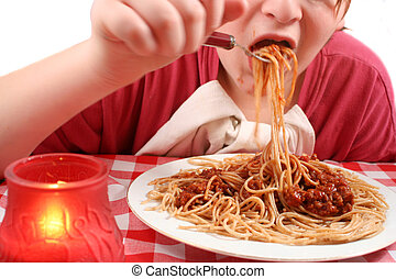eating pasta - young teen eating pasta (motion blur)