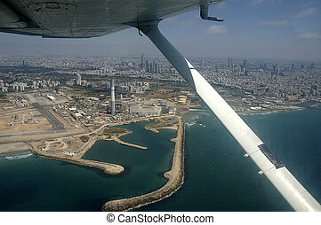 Tel-Aviv - bird\\\'s-eye view under plane wing