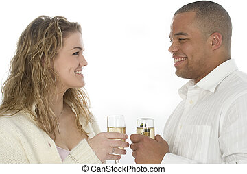Champagne Couple - Young couple with champagne, smiling at...