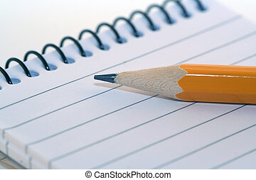 Taking note - notepad and pencil