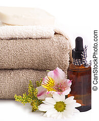 Spa still-life - Towels, soap, essential oil, daisy and...