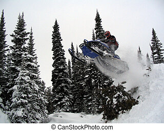 Snowmobile Jumping over trees