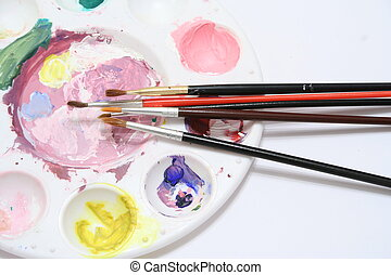 Artists Pallet - Selection of brushes on a paint pallet