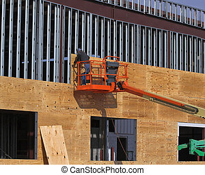 High Lift Worker - Steel worker installing plywood for new...
