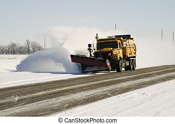 Snowplow - A snowplow clearing the highway after a winter...