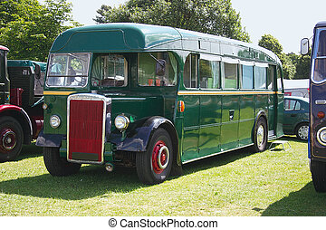 green bus - green vintage bus on show at a steam rally