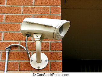 Security camera 1 - Security camera on a brick wall of a...