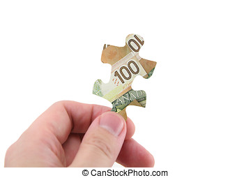 canadian dollar - hand hold canadian dollar puzzle