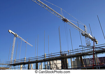 Building site - Two cranes tower over scaffolding