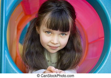girl in red tunel - girl on a playground