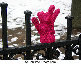 Lost glove on fence
