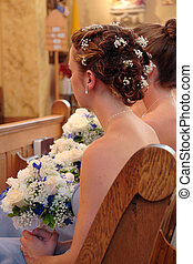 Bridesmaid 2 - Bridesmaid in church during wedding ceremony...