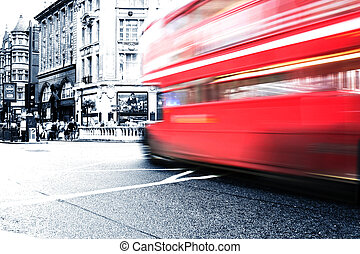 london bus - Red buss crossing intersection in London